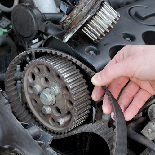 A Picture of a Mechanic Replacing a Timing Belt.
